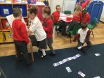 Working against the clock to complete the dominos add and subtract 10.