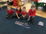 Working as a team to order words to make complete sentences.